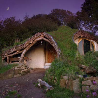 a cottage built into a hill; the hobbit house