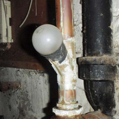 a light bulb used as a plumbing waste line cap
