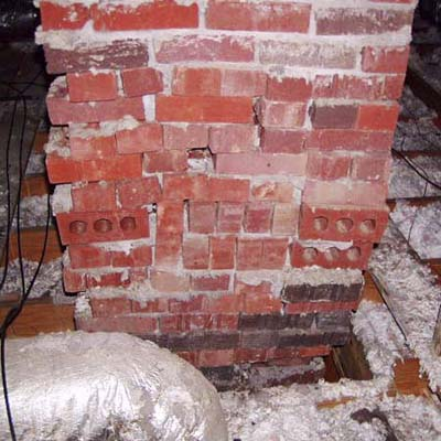a chimney in an attic space with little or no mortar