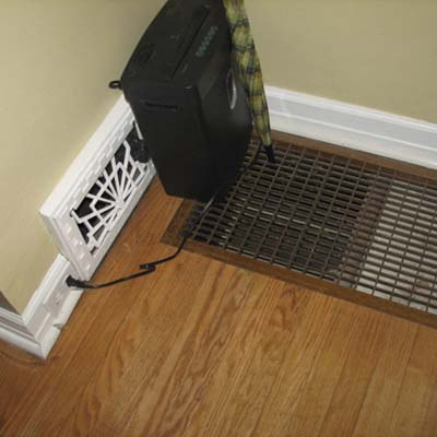an HVAC register placed right next to a cold air return on the floor