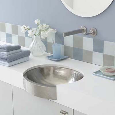 undermount sink from native trails has an apron front and is available in antique and brushed nickel finishes