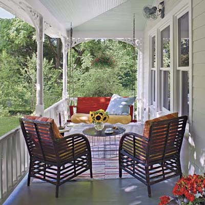 a porch in the farmhouse style