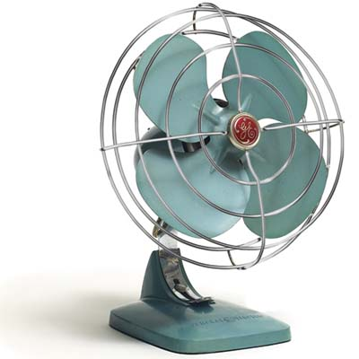 a vintage metal desk fan
