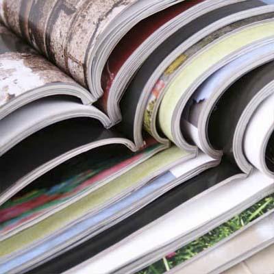 open magazines stacked binding to binding