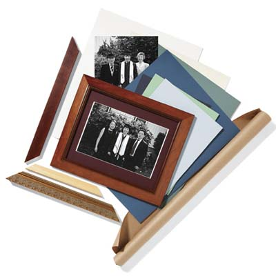 photo frame with family on top of paper and another family photo