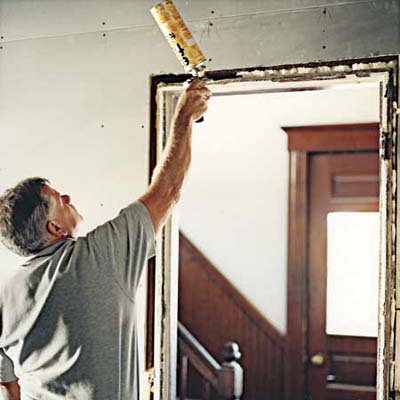 Tom Silva insulates at the East Boston TV Project from 2006