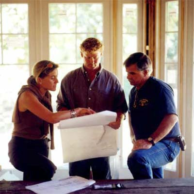 Kathy Marshall, Kevin O'Connor and Tom Silva consult floor plans for the Carlisle TV Project from 2004