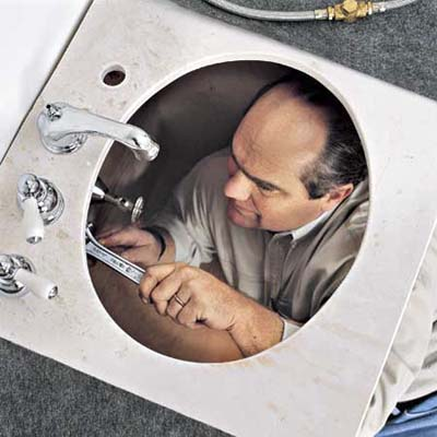 Richard Trethewey installing a sink at the Billerica TV Project from 1999