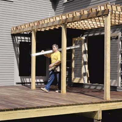 Tom Silva building the deck at the Billerica TV Project from 1999