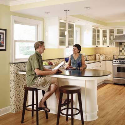 couple sits at their kitchen counter
