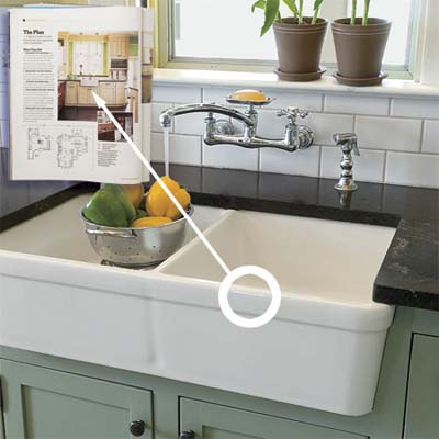 apron sink installed in this vintage look modern kitchen