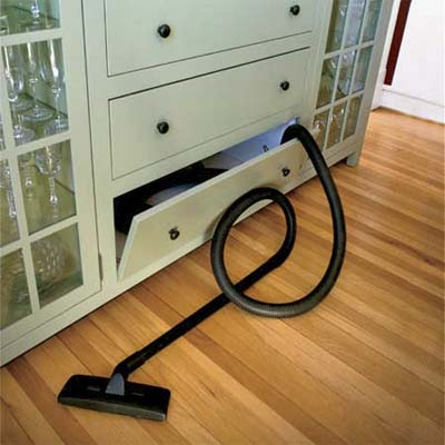 built in shop vac vacuum hidden in  a lower kitchen cabinet in this vintage look modern kitchen