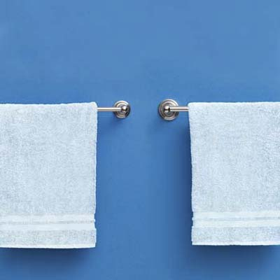 comparison of high end and moderately priced towel racks