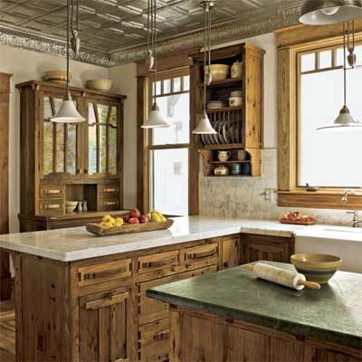 remodeled kitchen displaying hand-crafted cabinets and reclaimed tin ceilings