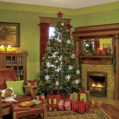 remodeled living room decorated for the holidays and featuring the tall oak baseboards and trim