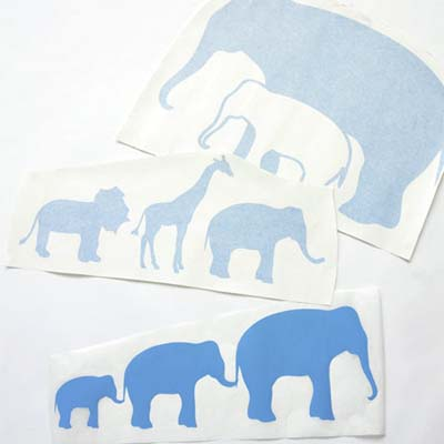 large wall stickers in the shapes of elephants and other circus animals