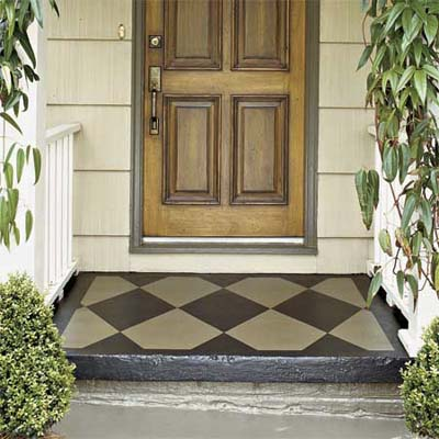 diamond shaped door mat painted on exterior entryway of house