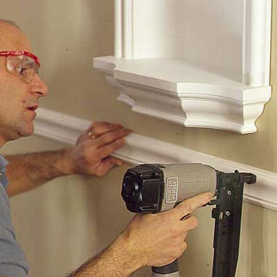 man installing a chair rail