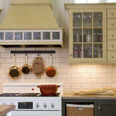 kitchen with a tile decorated range hood