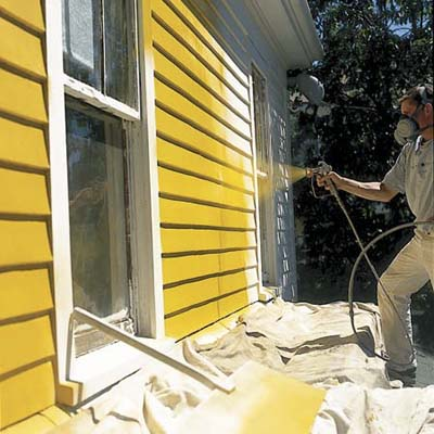spray painting a home's exterior