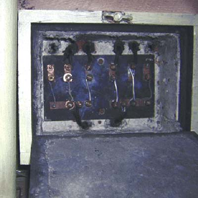 sub-panel on the basement ceiling