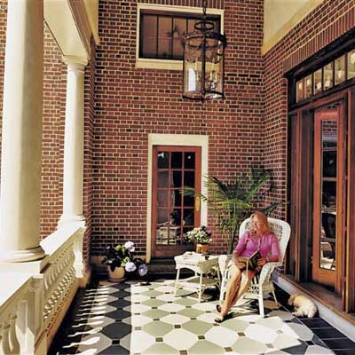 Former post office owner Sarah Belhasen on the veranda she created from the loading dock