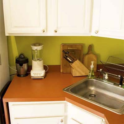 Cutting off the laminate counters created room for a full-sized refrigerator
