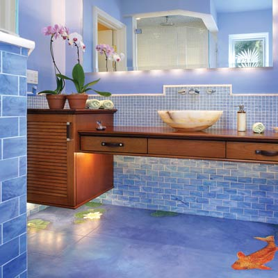zen style bath with porcelain blue tiled walls and floor with koi painted on the floor