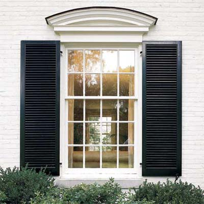 window with shutters viewed from the exterior of a house