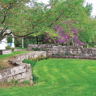 a retaining wall that demonstrates the backyard terrace