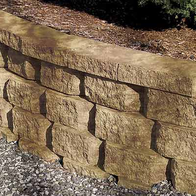 a retaining wall with stain applied to it for a warmer look