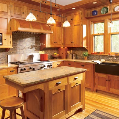 custom built cherry cabinets installed in an open kitchen