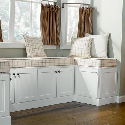 custom window seat designed using kitchen cabinets