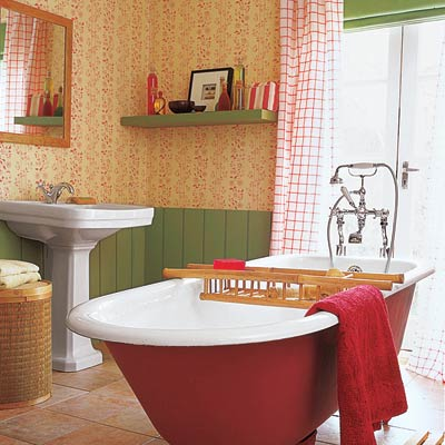upgraded bathroom with red freestanding tub