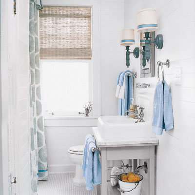 white bathroom with salvaged under sink storage and matching details
