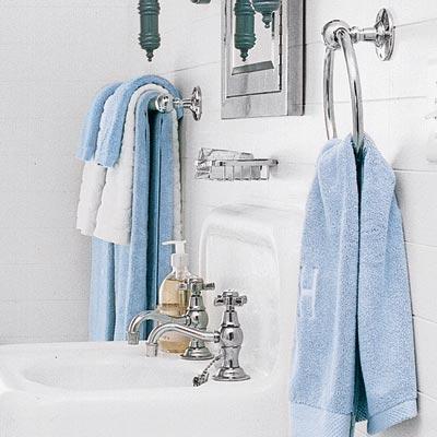 matching metal towel holders in upgraded bathroom