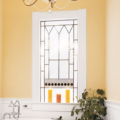 elegant bathroom with decorative stain glass window