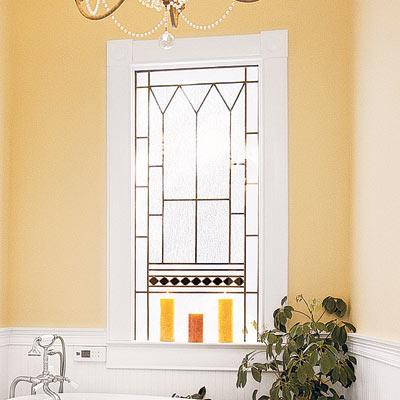 elegant bathroom with decorative stain glass window