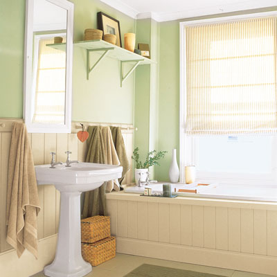 small charming green bathroom with paneled tub and pedestal sink