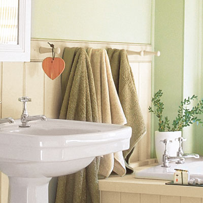 small charming bathroom with wainscoting and towel hooks