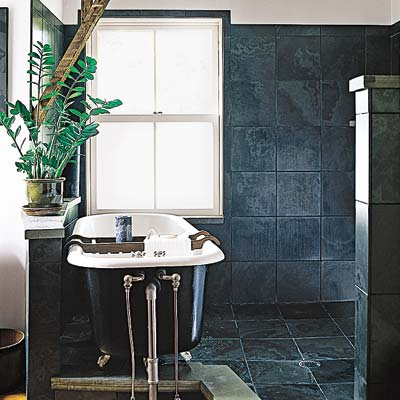 bathroom with dark ceramic tiled walls