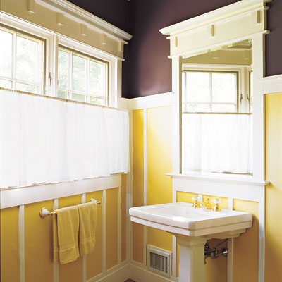 bathroom with gold and eggplant painted walls