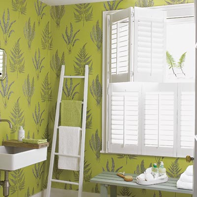 bathroom with green coated wallpaper