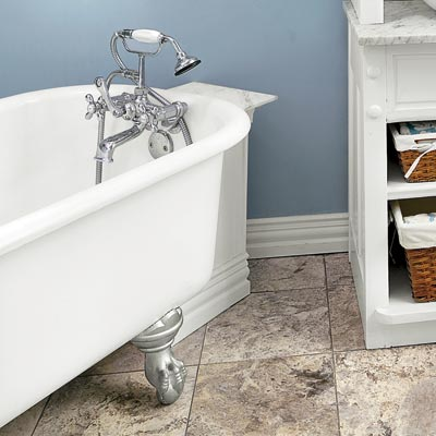 a homemade tub shelf with a marble top