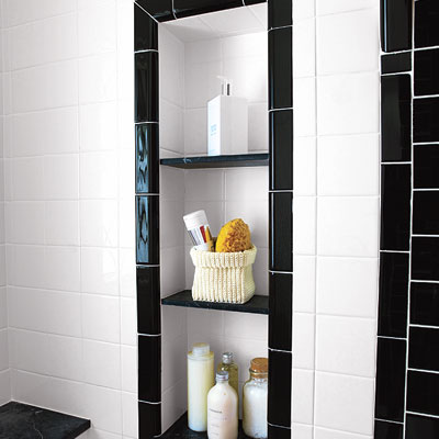 a tile built-in wall niche for bathroom storage