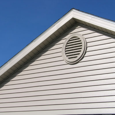 gable vent on clapboard house attic