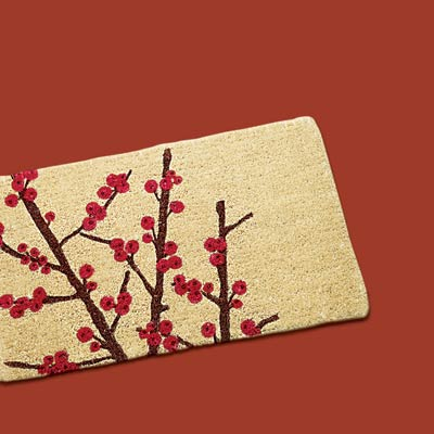 a welcome mat with winter berries design