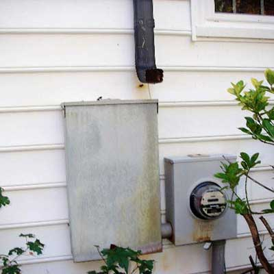 a downspout that drains right above an electrical circuit box