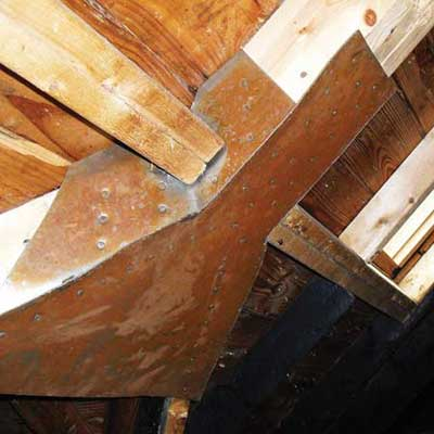 rafters in the attic reinforced with sheet metal