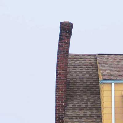 a chimney that is tilting perilously